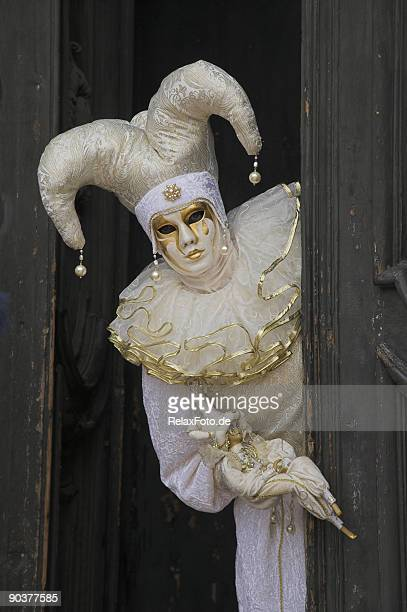 mask with white jester costume at carnival in venice (xxl) - harlequins stock pictures, royalty-free photos & images