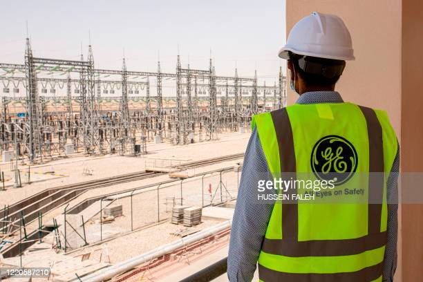 Mask-clad General Electric employee tours the Dhi Qar Combined Cycle Power Plant near the Iraqi city of Nasiriyah on June 16, 2020.