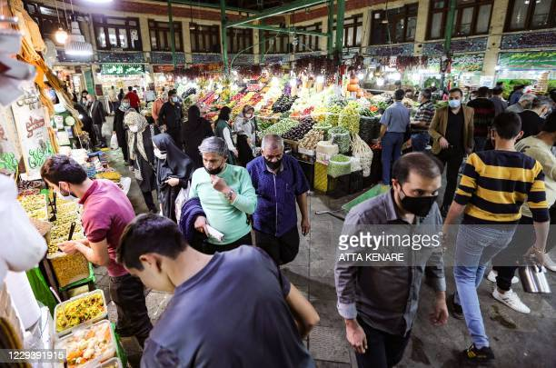 Mask-clad Iranians shop at the Tajrish Bazaar market in the capital Tehran, on November 1 amid the novel coronavirus pandemic crisis. - Iran...