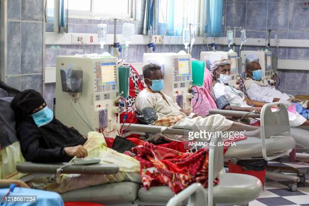 Mask-clad patients, suffering from kidney failure, receive dialysis treatment at al-Thawra hospital in Yemen's third city of Taez, on June 8, 2020. -...