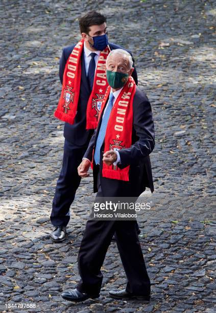 Mask-clad Portuguese President Marcelo Rebelo de Sousa wears a World Champions scarf during the Futsal National team's reception in Belem...