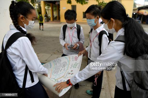 Maskclad students discuss their homework at a school in Phnom Penh on January 28 2020 Cambodia's health ministry reported the country's first case of...