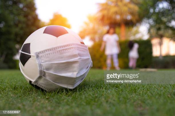 mask,covid-19,coronavirus,the concept of not playing football, - american football stock pictures, royalty-free photos & images