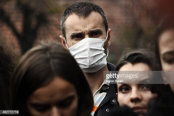 Masked activists and protesters gather in Pristina, Kosovo, to demonstrate against the prospect of using the Albania nation as a site for destroying...