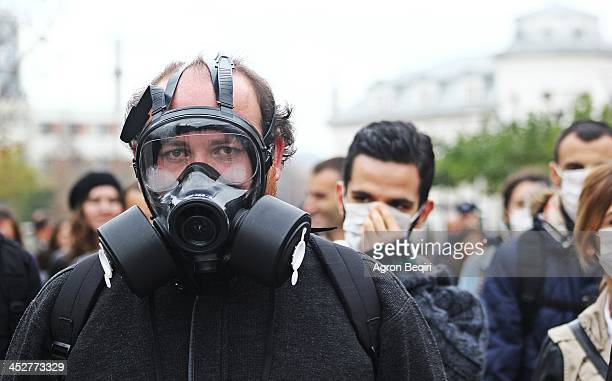 CONTENT] Masked activists and protesters gather in Pristina Kosovo to demonstrate against the prospect of using the Albania nation as a site for...