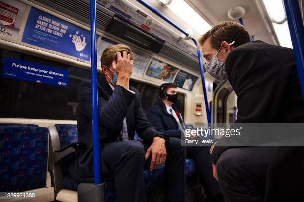 Masked and tired commuters travelling on the underground railway the last day before the second national coronavirus lockdown on 4th November 2020 in...
