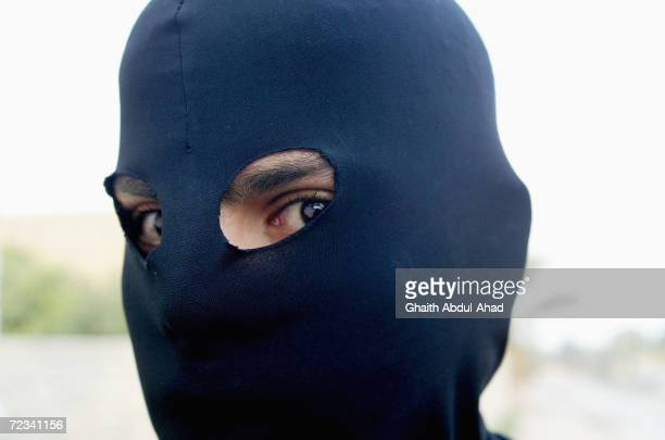 A masked Arab fighter is pictured on November 7 2004 in the city of Fallujah Iraq The Mujahadeen are preparing for a major US offensive against their...