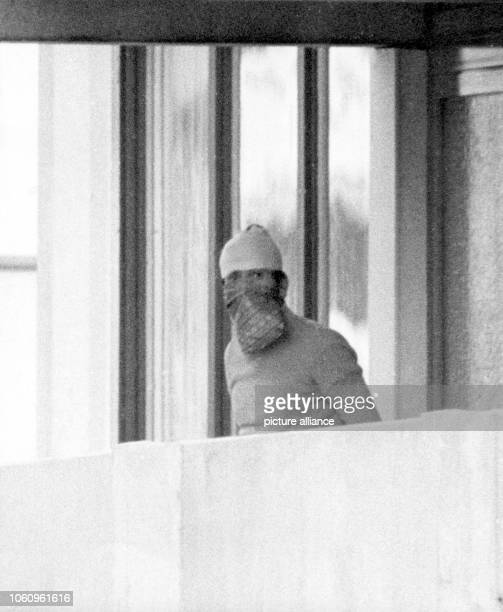 A masked Arab terrorist shows himself on the balcony of the Israeli team's accomodation in the Olympic Village on the 5th of September in 1972 Arabic...