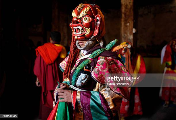A masked Bhutanese dancer waits backstage to perform at the annual Paro Tsechu festival on March 21 2008 in Paro Bhutan The festival is a tradtional...