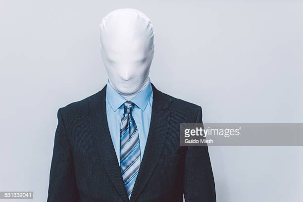 Masked businessman.