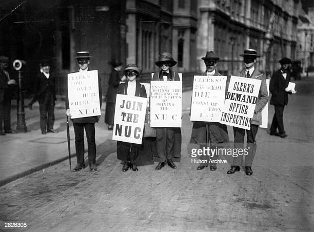 Masked clerks of the National Union of Clerks on their march to Hyde Park London