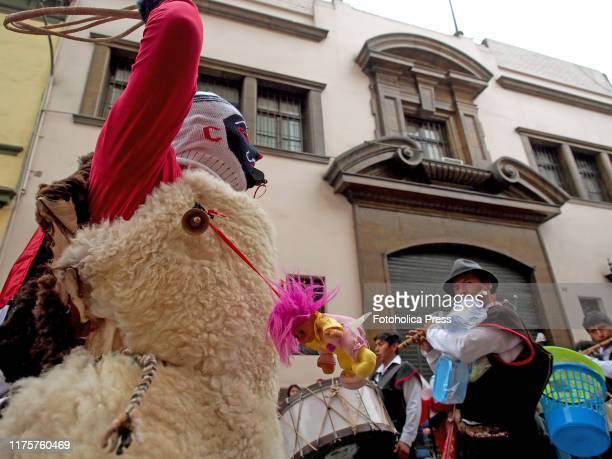 Masked dancer wearing typical costume when participating in the andean parade in downtown Lima in Honor of the Virgin of the Nativity.