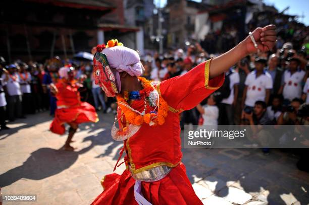 Masked dancers perform ritual triditional dance during Indra Jatra Festival celebrated in Basantapur Durbar Square Kathmandu Nepal on Sunday...