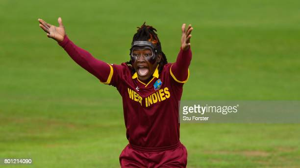 A masked Deandra Dottin appeals for a wicket during the ICC Women's World Cup 2017 match between Australia and West Indies at The Cooper Associates...