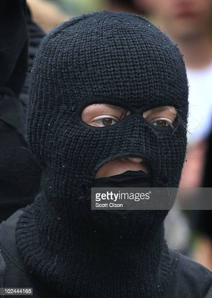 Masked demonstrator confronts police while protesting the G8/G20 summits on June 26, 2010 in Toronto, Ontario Canada. Store windows were smashed and...