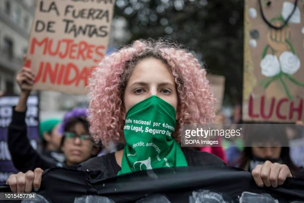 A masked demonstrator seen during a Ni Una Menos rally in protest against gender based violence in Lima Ni Una Menos demands that women should be...