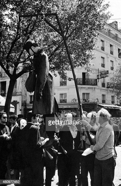 Masked demonstrators hang a dummy of a policeman during a demonstration in Paris Latin Quarter on May 13, 1968 during the May 1968 students revolt....