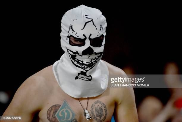 Masked Dynamo Kiev supporter looks on after the UEFA Europa League Group K first-leg football match between Rennes and Dynamo Kiev at Roazhon Park in...