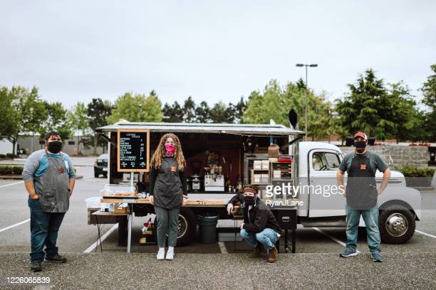 masked employees at mobile food truck - food and drink industry stock pictures, royalty-free photos & images