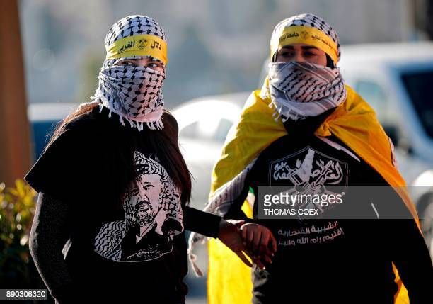Masked female Palestinian protesters gather during demonstration in the West Bank city of Ramallah on December 11 2017 as protests continue to flare...