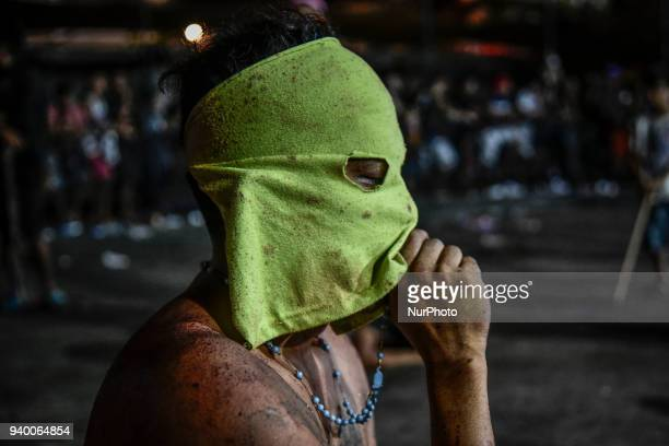 A masked flagellants prays during Good Friday Lenten rites in Navotas Metro Manila Philippines March 30 2018 Ezra Acayan/NurPhoto