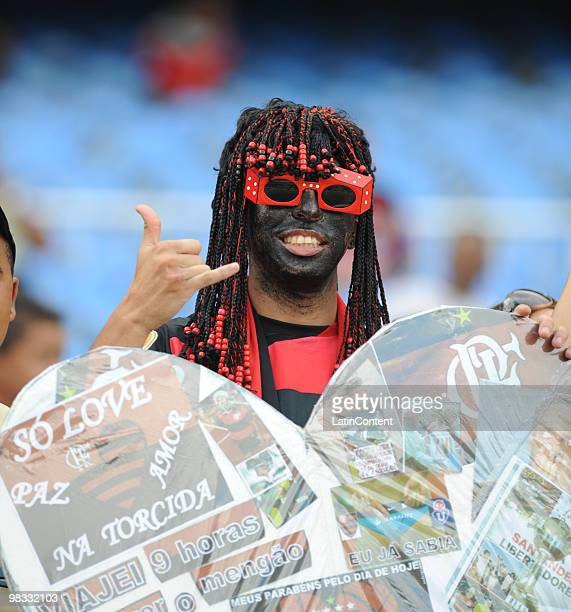 A masked Flamengo's fan attends Maracana stadium to cheer their team up against Universidad de Chile as part of 2010 Libertadores Cup match on April...