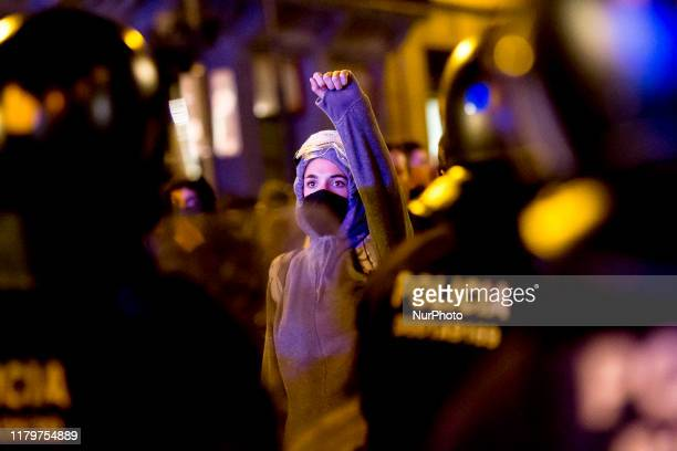 Masked girl during the demonstrations. Protesters surround the central police station of the Spanish police in Via Laietana, in rejection of what...