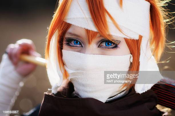 Masked girl with blue eyes and blond hair