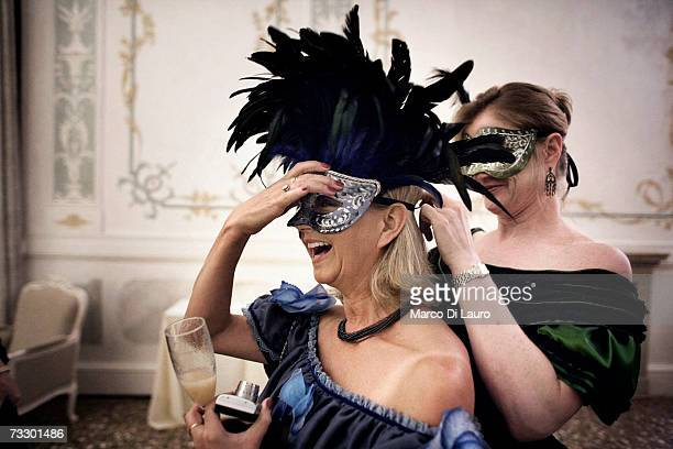 Masked guest attend the 'Ridotto' party organized by the Club Culturale Italiano at the Hotel Monaco during the Carnival on February 10 2007 in...