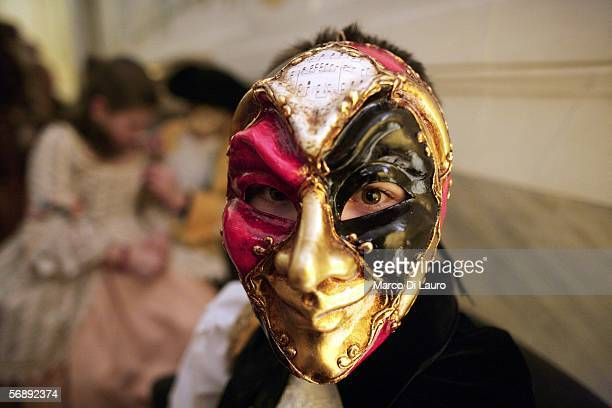 """Masked guest attends """"The Ridotto"""" party organized by the Club Culturale Italiano at the Hotel Monaco during the Carnival February 18, 2006 in..."""
