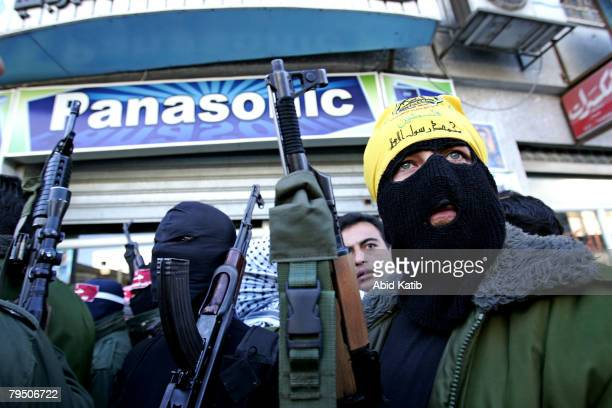 Masked gunmen attend a press conference while Abu Thaer a Palestinian spokesman of the Al-Aqsa Brigades the military wing of the Palestinian...
