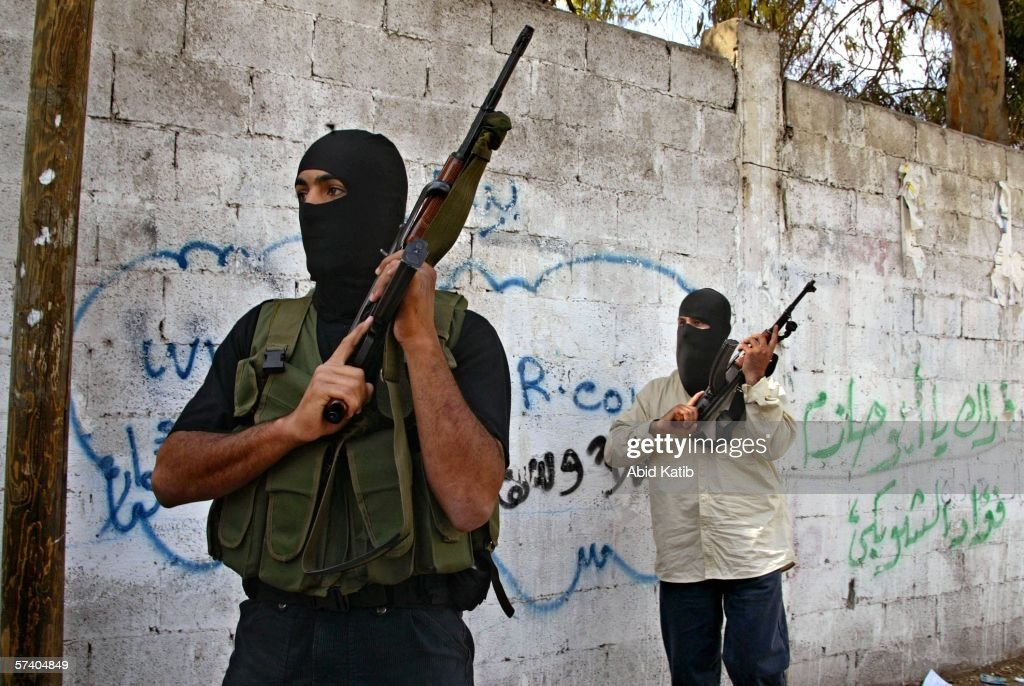 Masked Hamas fighters take their position as they back up Palestinian policemen as they clash with gunmen of the former ruling Fatah faction after the gunmen stormed the Palestinian Health Ministry April 23, 2006 in Gaza City, Gaza Strip. Three people were wounded when the gunmen clashed with the policemen, who backed by Hamas fighters, came to the rescue of Basim Naeem, the Palestinian Health Minister. Hamas blamed Fatah for the violence, but Fatah officials denied the gunmen were affiliated with the party.