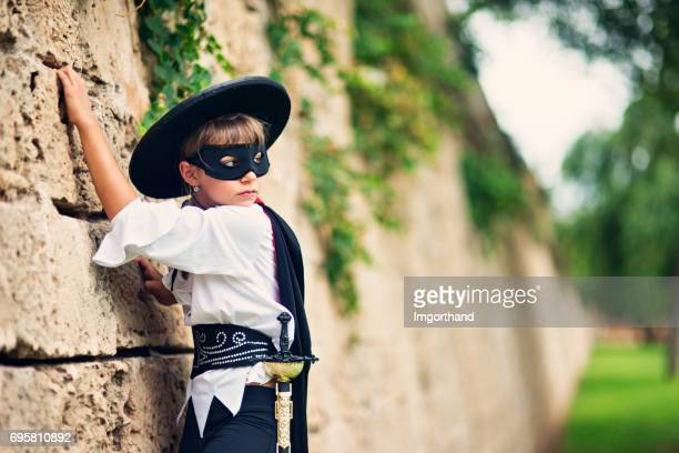 Masked hero girl climbing the wall