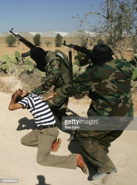 Masked Islamic Jihad militants members of the Al-Quds Army in action during the last day of a military-style training program August 11, 2005 in the...