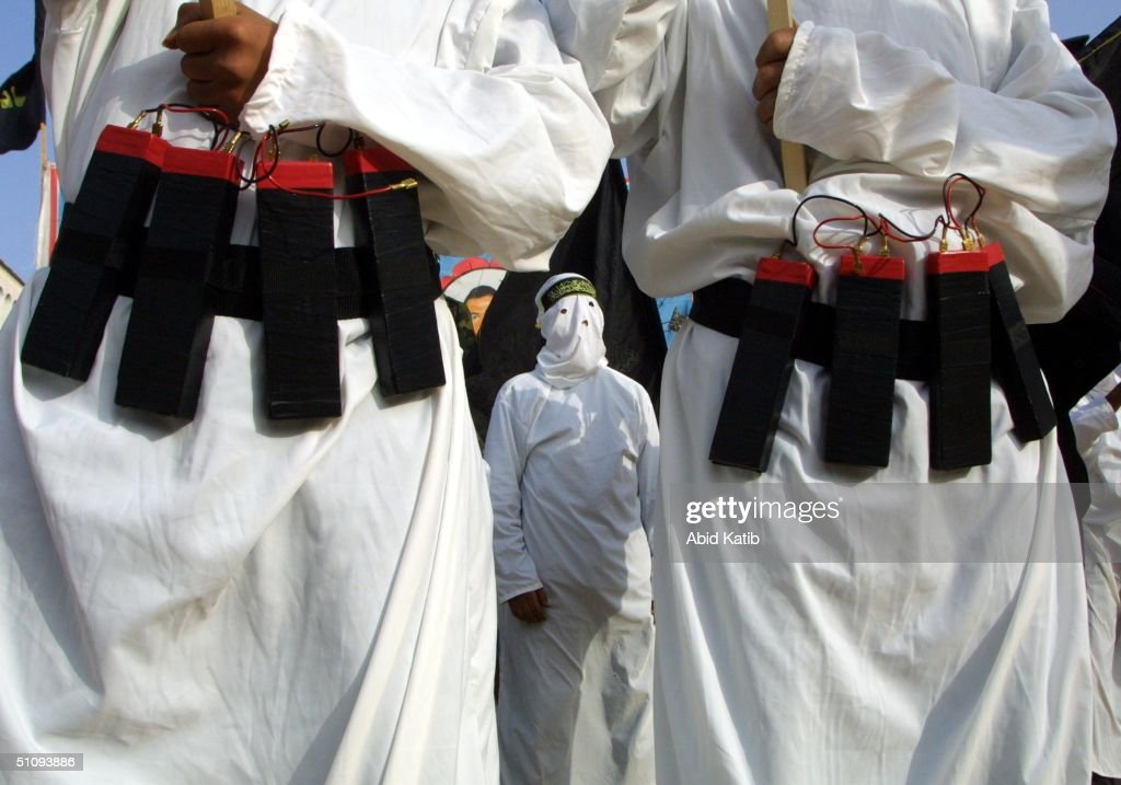 Masked Islamic Jihad Militants Wear Explosive Belts During A Rally Commemorating Mohammed... : News Photo