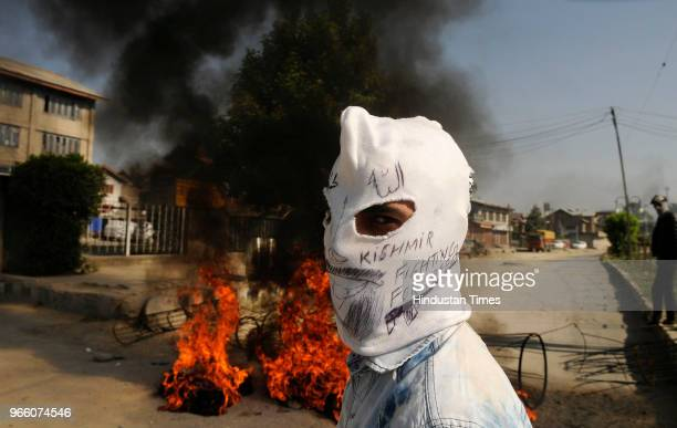 A masked Kashmiri protesters looks on during clashes in downtown on June 2 2018 in Srinagar India Clashes erupted between protestors and forces at...