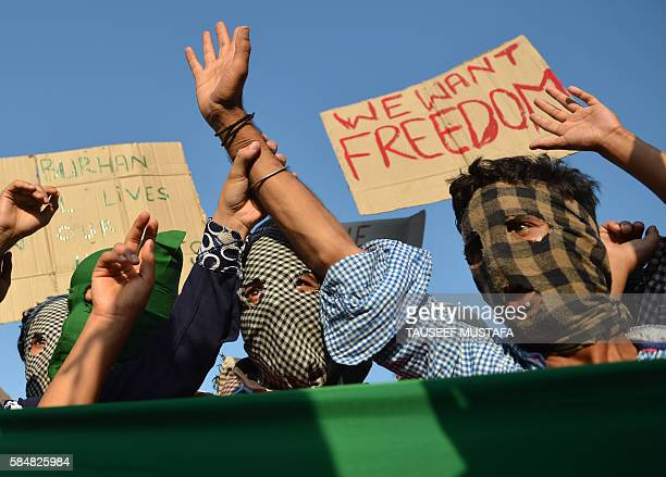 TOPSHOT Masked Kashmiri protestors shout proPakistan and profreedom slogans during a protest in downtown Srinagar on July 31 2016 More than 50 people...