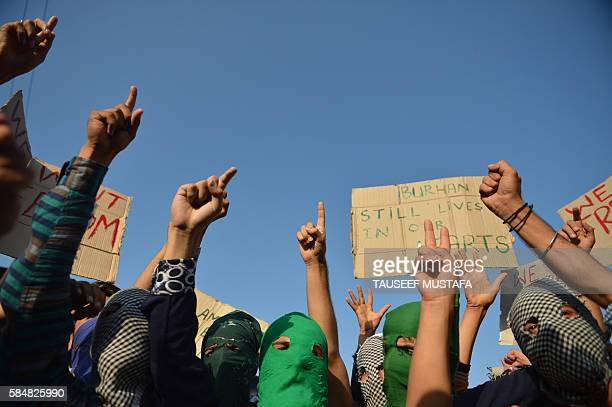 Masked Kashmiri protestors shout proPakistan and profreedom slogans during a protest in downtown Srinagar on July 31 2016 More than 50 people have...