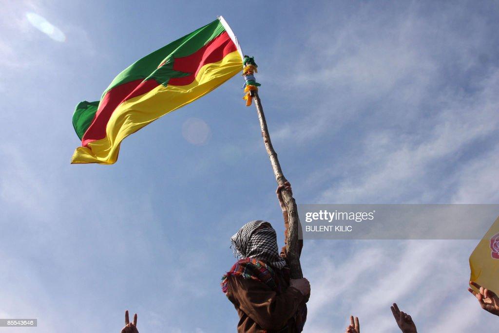 A masked Kurdish man waves a PKK's flag : News Photo