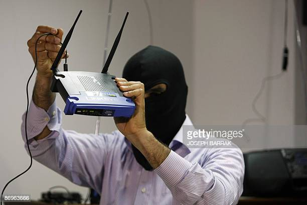 A masked Lebanese secret service officer shows to the media at the Lebanese security services headquarters in Beirut on May 11 2009 a wireless...