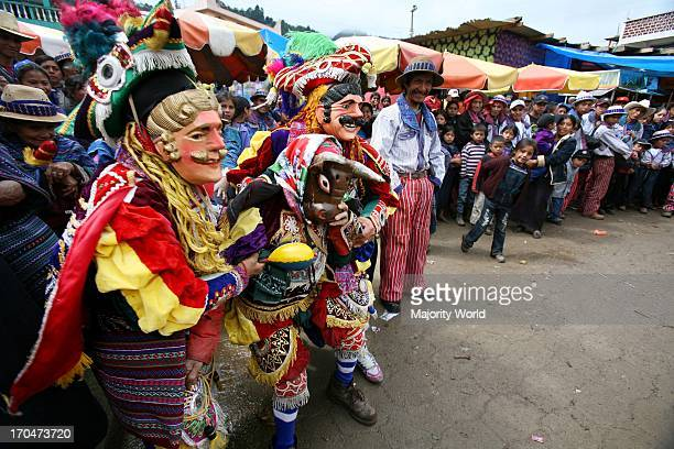 Masked Mam Mayans participate in the Dance of the BullsO in the central plaza of Todos Santos Cuchumatan Guatemala October 31 on the first day of the...
