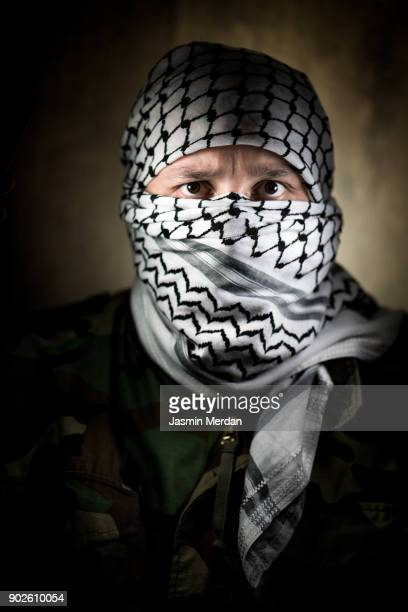 masked man portrait with palestinian kaffiyeh - extremism stock pictures, royalty-free photos & images