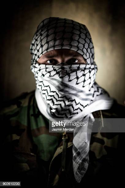 Masked man portrait with Palestinian kaffiyeh