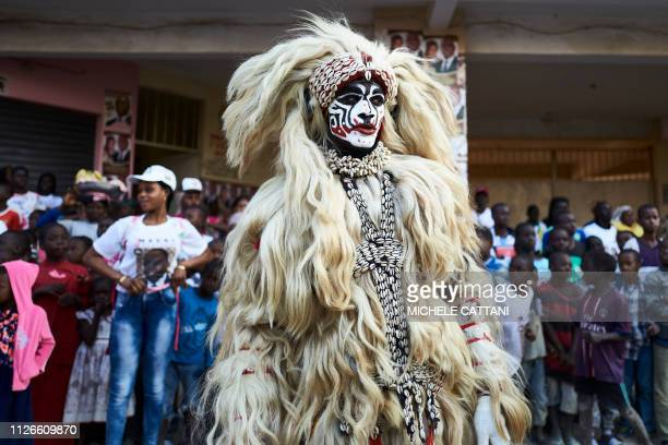 TOPSHOT A masked man poses during a rally in support of the outgoing Senegal's president Macky Sall on February 21 2019 in Dakar The Senegal's...