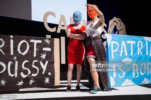 A masked member of protest band Pussy Riot and Pussy Riot performer Nadya Tolokonnikova attend the Cannes Lions Festival 2017 on June 22 2017 in...