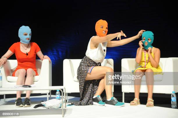 A masked member of protest band Pussy Riot Pussy Riot performer Nadya Tolokonnikova and her daughter Gera Verzilova attend the Cannes Lions Festival...