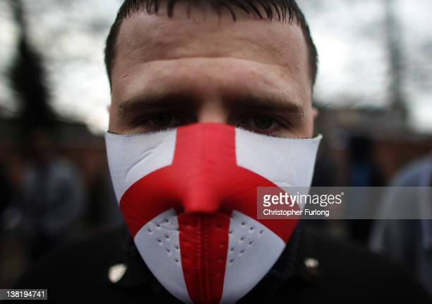 A masked member of the English Defence League takes part in a demonstration through the streets of Leicester on February 4 2012 in Leicester England...