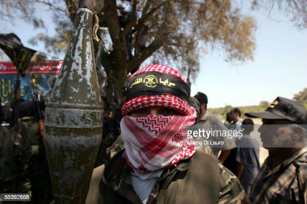 Masked member of the militant group, Islamic Jihad, stands during a media conference at the synagogue in the former Jewish settlement of Netzarim...