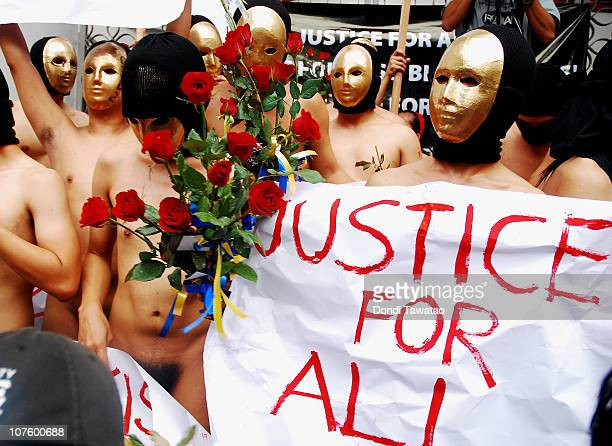 Masked members of a fraternity parade during the traditional 'Oblation Run' at the University of the Philippines on December 15 2010 in Quezon City...