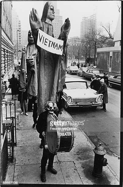 Masked members of the Bread Puppet Theater stage a protest of the Vietnam War in Washington Square New York New York March 15 1965